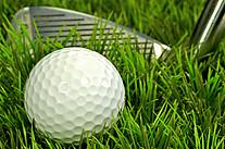 Golfball und Schläger