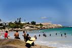 Menschen baden am Strand in Südafrika